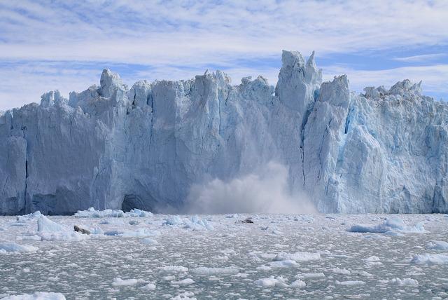 by ClaramedC on Flickr.Massive blocks of ice falling from Eqip Sermia Glacier in Western Greenland.