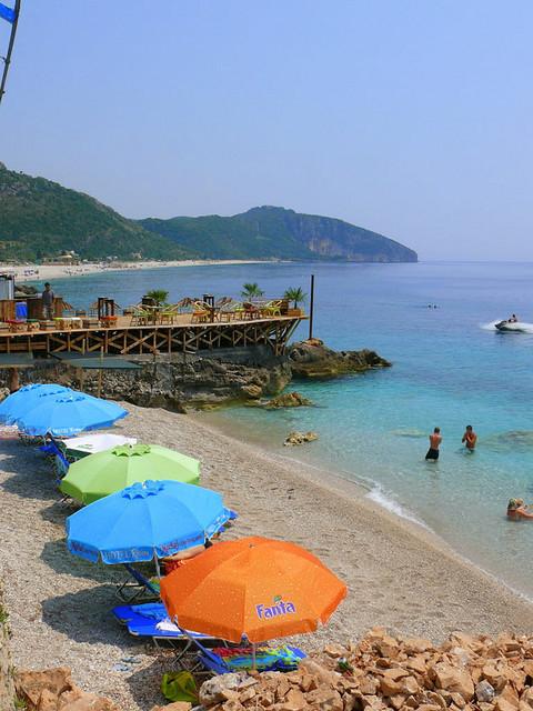 Colorful umbrellas on the beach in Dhermi, Albania