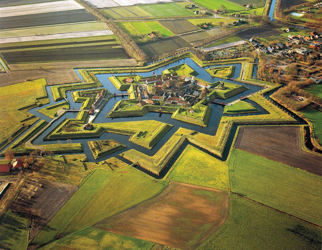 "allthingsworthsharing:"" Fort Bourtange, Groningen, Netherlands. Built during the Eight Year War  under William I of Orange."""