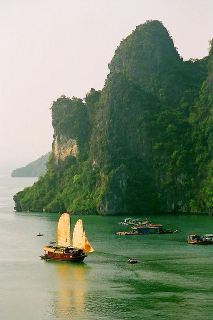 A junk with sails unfurled in Ha Long Bay, Vietnam