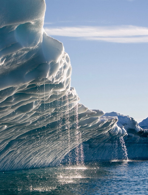 Melting water streams from iceberg in Disko Bay, Greenland