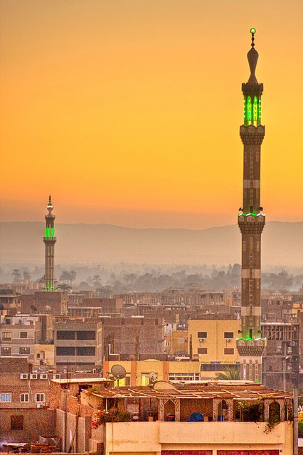 Sunset on the cityscape and the minarets of Luxor, Egypt