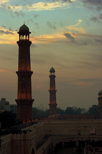 The minarets of Badshahi Masjid at dusk in Lahore, Pakistan